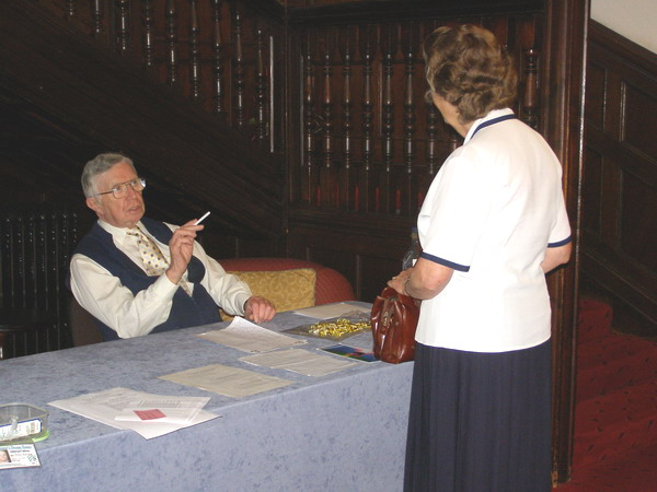 Don Galloway seated at the desk in the entrance hall of Cober Hill.